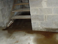 Water Pouring into a Edmonton Basement through Hatchway Doors